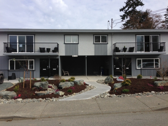 Outside of 441 Cedar 4-plex. This property features 2 x 2 bedroom and 2 x 1 bedroom suites.