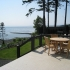 Large Ocean View Outdoor Deck with Teak Patio Furniture and Webber Barbecue.